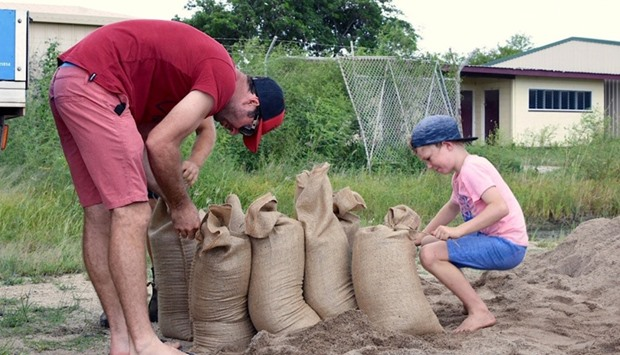 Residents fill sandbags in preparation for the arrival of Cyclone Debbie in the northern Australian