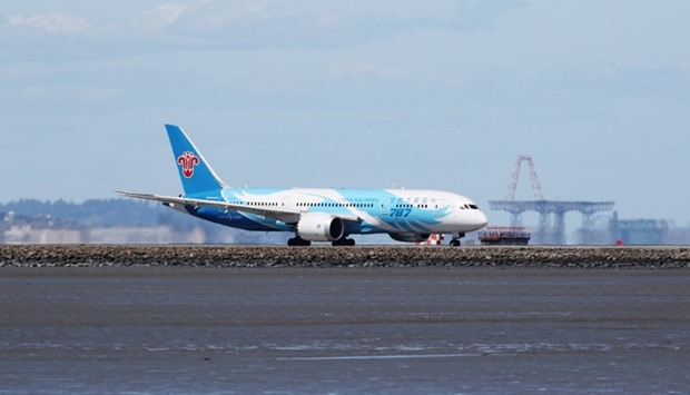 A China Southern Boeing 787, with Tail Number B-2727, taxis at San Francisco International Airport,