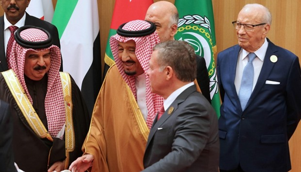 Jordan's King Abdullah II (2-R) speaks to Saudi King Salman (2-L) as Tunisian President (R) stands b