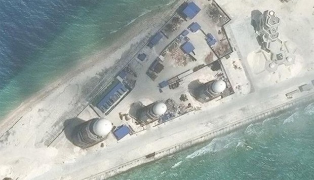 Construction is shown on Fiery Cross Reef, in the Spratly Islands, the disputed South China Sea