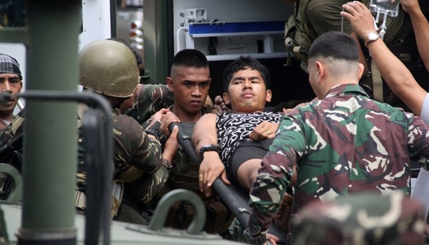 Philippine soldiers, wounded in an ongoing clash with Abu Sayyaf group, arrive at a military hospita