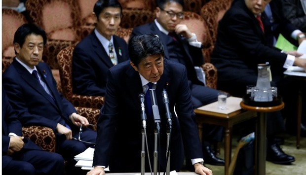 Japan's Prime Minister Shinzo Abe (C) speaks at the upper house parliamentary session after reports