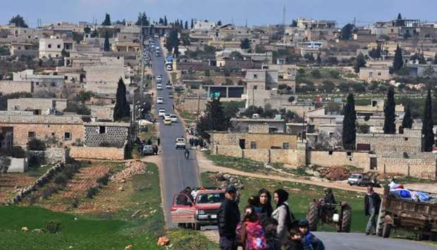 Civilans fleeing Afrin after Turkey said its army and allied rebels surrounded the Kurdish city in n