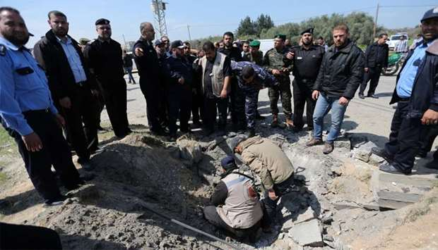 Hamas police chief Tayseer al-Batish inspects the site of an explosion that targeted the convoy of P