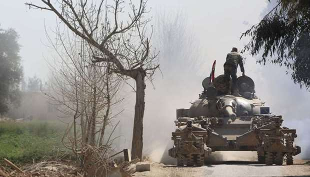 Syrian government forces deploy in the captured town of Beit Sawa it the Eastern Ghouta region on th