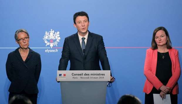 French Government's Spokesperson Benjamin Griveaux (C) speaks as French Transports Minister Elisabet