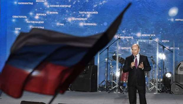 Russian President Vladimir Putin addresses supporters during a rally