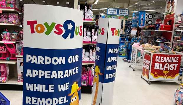 A construction sign is posted inside of a Toys R' Us store in San Rafael