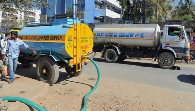 Tankers delivering water to apartments in Bangalore