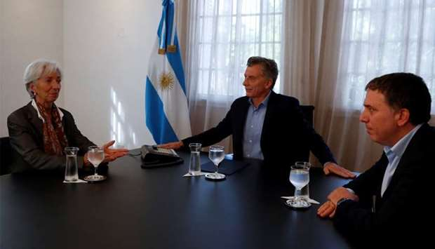 Christine Lagarde, Managing Director of the IMF, Argentina's President Mauricio Macri and Minister o