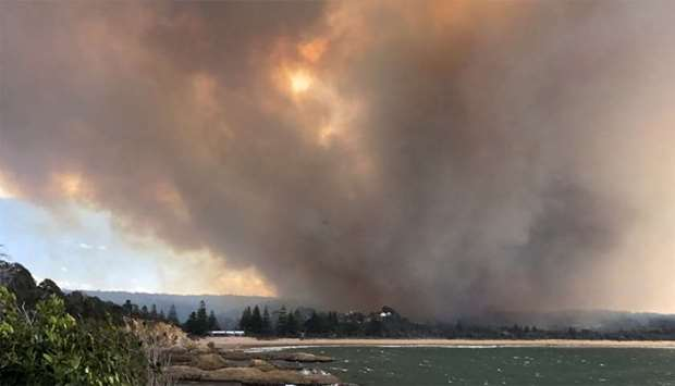 Smoke rising from fires in the village of Tathra on the south coast of New South Wales