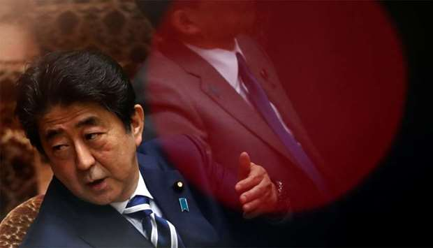Japan's Prime Minister Shinzo Abe attend an upper house parliamentary session in Tokyo