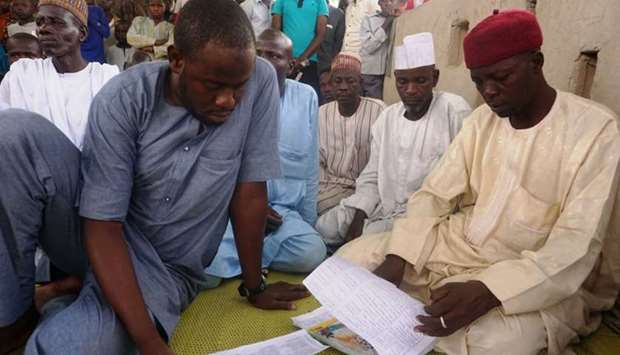 Parents go through list of 110 schoolgirls kidnapped by Boko Haram from Government Girls Technical C