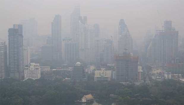 Skyline is seen through morning air pollution in Bangkok