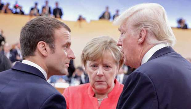 Emmanuel Macron of France and Angela Merkel of Germany talk with Donald Trump. (file picture)