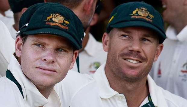 Steve Smith (L) captain of Australia and teammate David Warner (R)