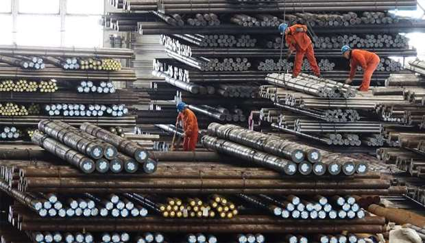 Workers transport steel bars at a plant of Dongbei Special Steel Group Co Ltd. in Dalian, Liaoning p