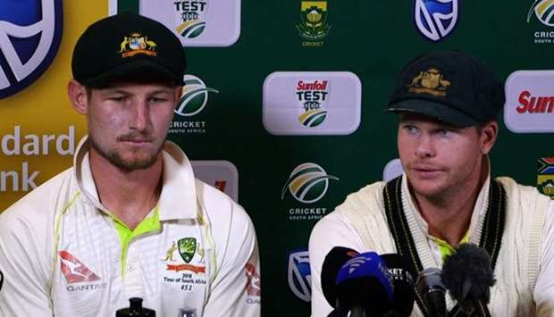 Australia's captain Steve Smith (R), flankled by teammate Cameron Bancroft