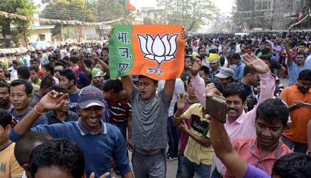 Indian supporters of the Bharatiya Janata Party (BJP) state a rally in Tripura