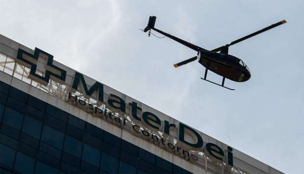 A helicopter leaves Mater Dei hospital carrying onboard Brazil and Paris Saint-Germain superstar Ney