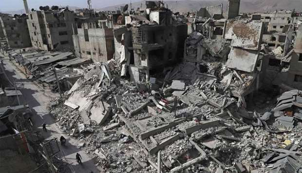 A general view shows several destroyed buildings in Douma, in the rebel enclave of Eastern Ghouta on