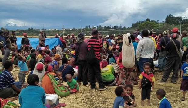 People displaced by a March 1 earthquake gather at a relief centre in the central highlands of Papua