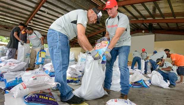 ExxonMobil PNG staff packing relief packages at a Salvation Army base in Papua New Guinea.