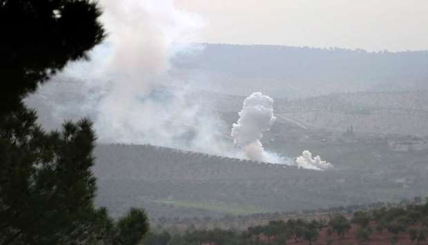 Smoke billows from the town of Sharran, which is controlled by Kurdish People's Protection Units (YP