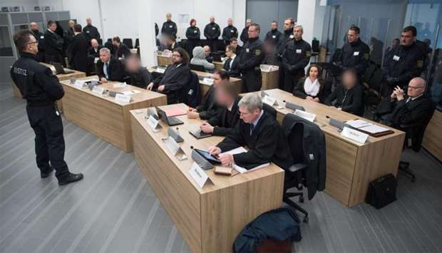Defendants sit next to their lawyers at a courtroom in Dresden, eastern Germany, where members of th