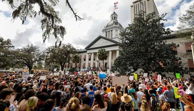 Protestors rally outside the Capitol urging Florida lawmakers to reform gun laws