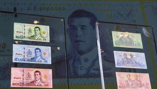 New baht banknotes featuring Thailands King Maha Vajiralongkorn