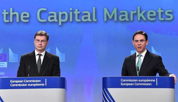 European Commission Vice-Presidents Valdis Dombrovskis (L) and Jyrki Katainen