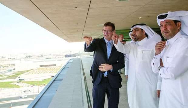 QF's Ghanim Hassan al-Ibrahim, Qatar Shell's Andre Faulkner and other officials at QF headquarters