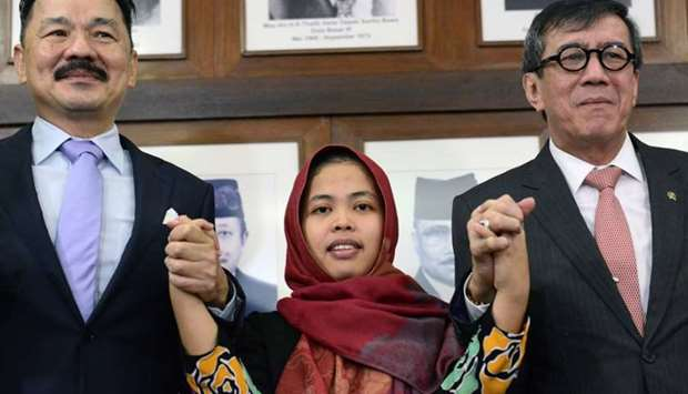 Siti Aisyah attends a news conference