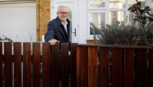 Britain's opposition Labour party leader Jeremy Corbyn leaves his house in north London