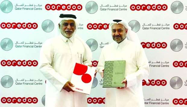 Ooredoo COO Yousuf Abdulla al-Kubaisi and QFC Authority CEO Yousuf Mohamed al-Jaida signed the MoU a