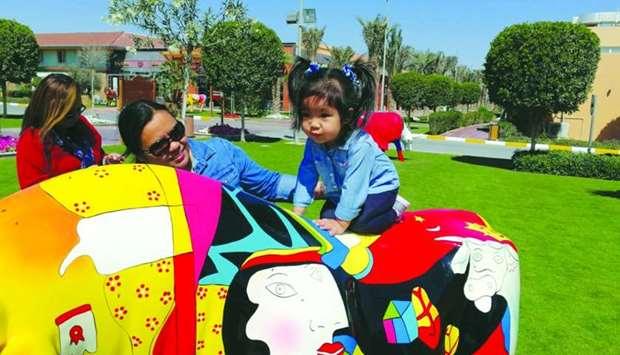 Chaine Dimaano takes her daughter Kaliya at a play area at Baladna Park.