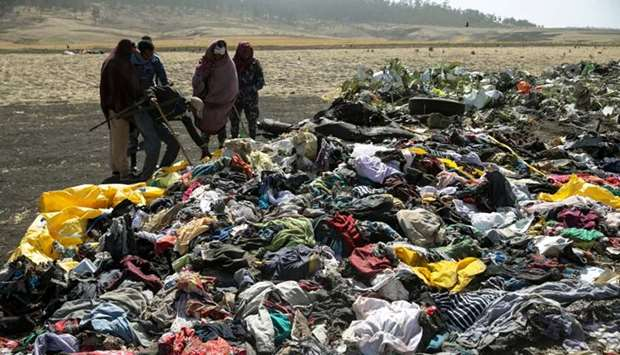 Ethiopian policemen search through the passengers belongings at the scene of the Ethiopian Airlines
