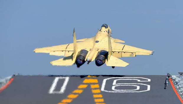 A Chinese navy fighter jet taking off from an aircraft Carrier.