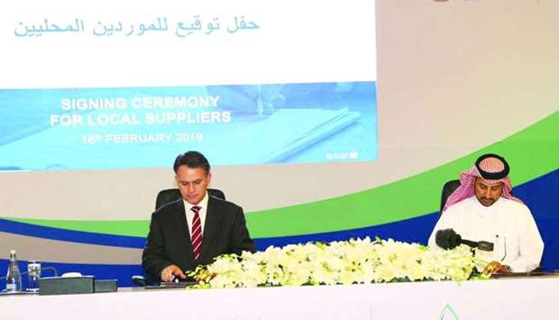 Assili and al-Marri signing the agreement on the sidelines of the Tawteen initiative launching cerem