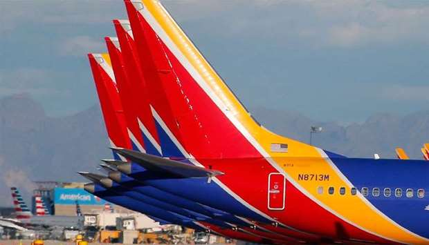A group of Southwest Airlines Boeing 737 MAX 8 aircraft sit on the tarmac at Phoenix Sky Harbor Inte