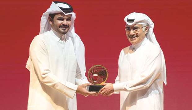 Qatar Olympic Committee (QOC) president HE Sheikh Joaan bin Hamad al-Thani (left) honours His Highne