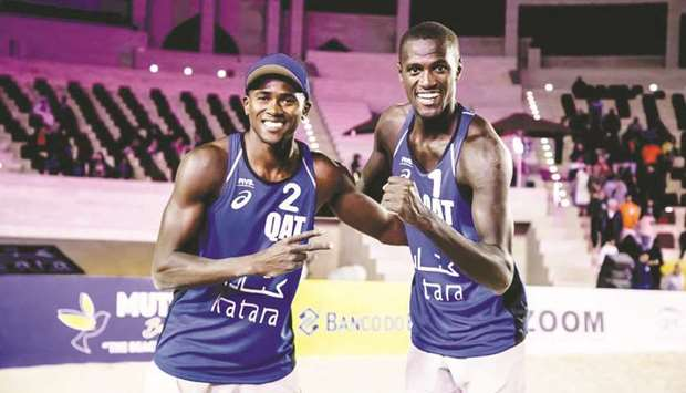 Qatar's Cherif Younousse (right) and Ahmed Tijan