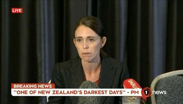 New Zealand's Prime Minister Jacinda Ardern speaks on live television following fatal shootings at t