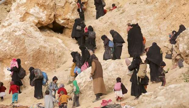 Surrendering families of Islamic State militants in the village of Baghouz