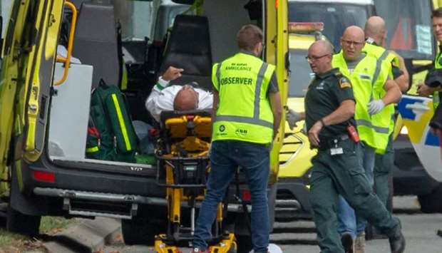 An injured person is loaded into an ambulance following a shooting at the Al Noor Mosque in Christch