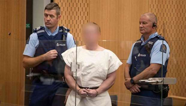 Brenton Tarrant, the man charged in relation to the Christchurch massacre appear in the dock charged