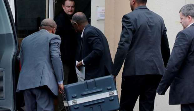 Men unload a case containing the black boxes from the crashed Ethiopian Airlines Boeing 737 MAX 8 ou