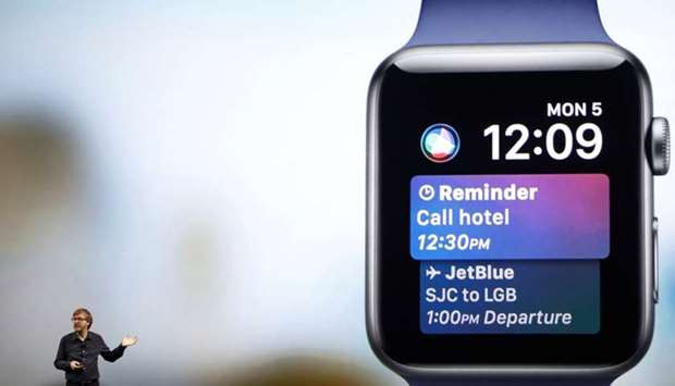 Kevin Lynch, VP of Technology at Apple, speaks near a projection of an Apple Watch