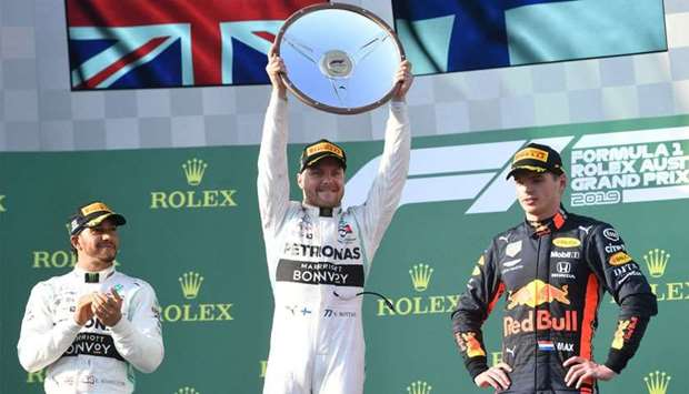 Mercedes' Valtteri Bottas holds the winners trophy after winning the Formula One F1 Australian Grand